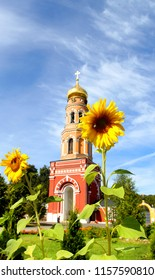 Photo of the Orthodox bell tower illuminated by the sun in Russia