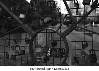 Photo of padlocks by couples on a bridge in Košice in black and white.