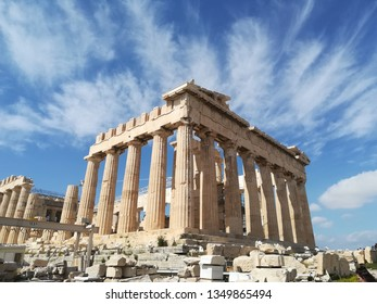 A photo of the Parthenon in Athens. It sits in the centre of the Acropolis at the top of the hill.