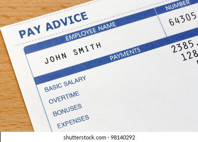 Photo of a payslip. The payslip is a mock up the names and all other information on it is fictional.