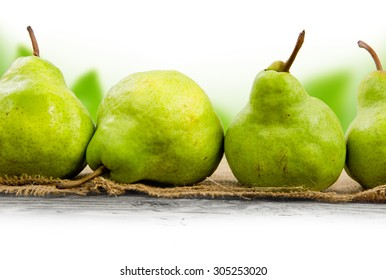 Photo of pears on burlap with abstract background and white space