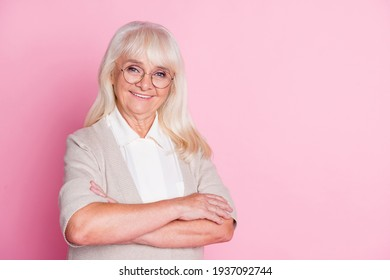 Photo of pensioner old lady crossed hands toothy smile look camera wear beige cardigan isolated pastel pink color background