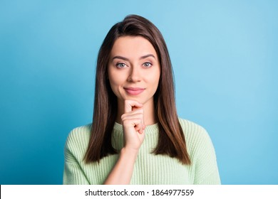 Photo of pensive charming girl finger chin look camera smile wear green sweater isolated blue color background