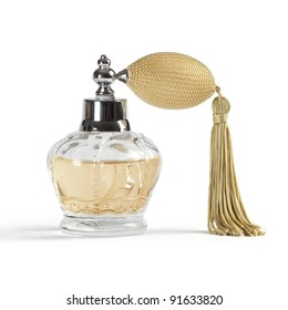 Photo of a perfume spray bottle in the shape of a crown, isolated on white background.