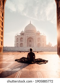 Photo Of Person Sitting in Front Of The Taj Mahal