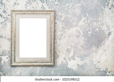 Photo or picture frame blank hanging on vintage aged grunge textured concrete wall background. Retro old style filtered photo