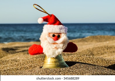 Photo Picture of Santa Claus Toy on the Sand Beach
