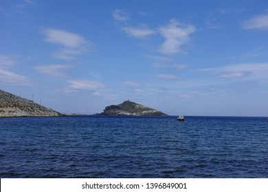 Photo from picturesque beautiful fishing village and small harbour of Panormos, Tinos island, Cyclades, Greece
