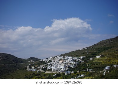 Photo of picturesque beautiful village of Isternia with traditional Cycladic architecture famous for marble artists, Tinos island, Cyclades, Greece