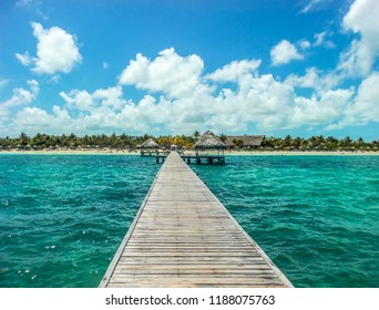 Photo of a pier on a beach in Cayo Guillermo, Cuba, in turquoise color.