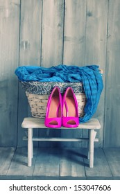 Photo of pink shoes and blue scarf