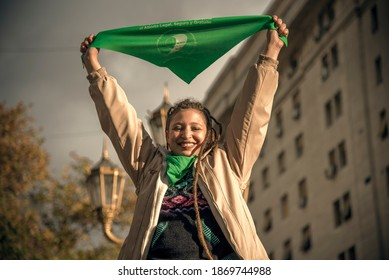 Photo of political activist woman for legal abortion in the congress from 2018. Green handkerchief. Buenos Aires, Argentina