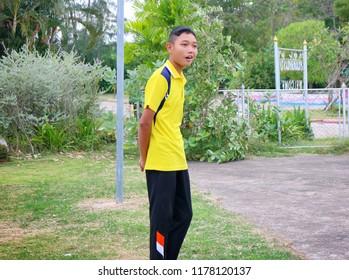 Photo of A poor thai student boy in his PE uniform of Pannampran wittaya school at Hua Hin, Thailand December 4, 2017