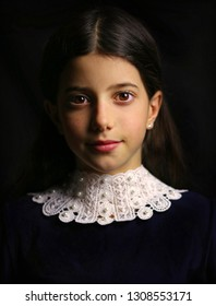 Photo portrait of beautiful girl in old masters style on black background.