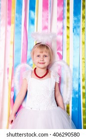 photo of Portrait of beautiful princess girl in white dress with white nimbus and wings