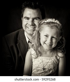 photo portrait of father and daughter on black