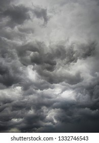 photo in portrait format of surreal sky, with dark clouds in shades ranging from dark gray to brown, occupying the sky in whirlwind, sao paulo, Brazil