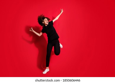 Photo portrait full body view of crazy girl dancing standing on one leg isolated on vivid red colored background