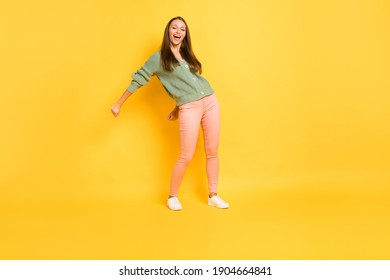 Photo portrait full body view of girl doing modern dance flossing isolated on vivid yellow colored background