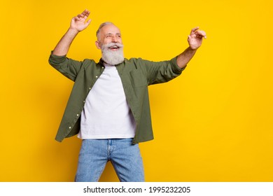 Photo portrait of grandfather cheerful happy dancing relaxing at party isolated bright yellow color background