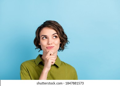 Photo portrait of nice girl having new idea trying to find solution dreaming looking up having a plan isolated on blue color background with copyspace - Shutterstock ID 1847881573
