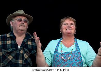 photo of portrait senior male and female on black