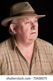 photo portrait of senior male wearing a hat