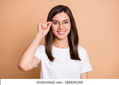 Photo portrait of smart girl wearing eyewear smiling in casual stylish outfit isolated pastel beige color background