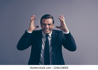 Photo portrait of ugly crazy with teeth showing fists mad freelancer entrepreneur looking at camera holding hands near head isolated grey background
