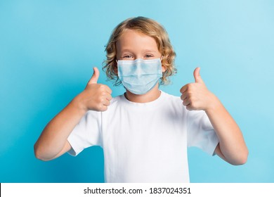 Photo of positive boy show thumb up sign wear respirator casual style outfit isolated over blue color background