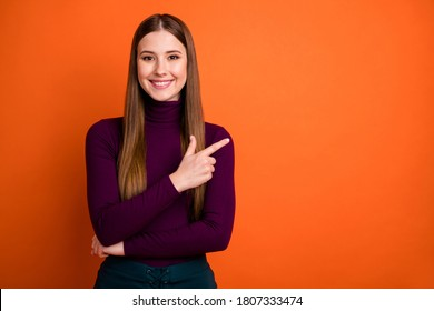 Photo of positive cheerful girl promoter point index finger copyspace indicate ads promo recommend suggest select wear good look clothes isolated over bright color background
