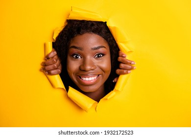 Photo of positive funny adorable lady toothy smile look camera through bright yellow color background