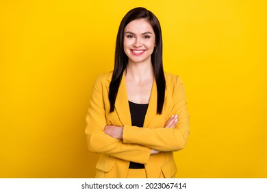 Photo of pretty adorable young lady dressed formal blazer smiling arms crossed isolated yellow color background