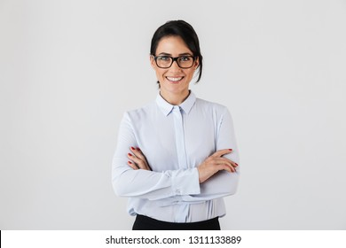 Photo of pretty businesslike woman wearing eyeglasses standing in the office isolated over white background