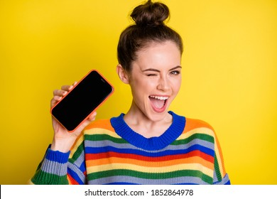 Photo of pretty cool brunette girl show telephone blink wear rainbow sweater isolated on bright yellow color background