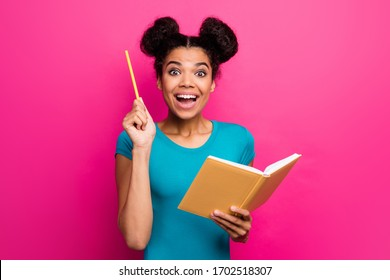Photo of pretty funny dark skin lady two buns raise pencil hold planner have crazy creative smart idea for new book novel wear blue casual t-shirt isolated magenta color background