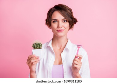 Photo of pretty hairdo person charming face holding razor little cactus flower isolated on pink color background