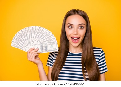 Photo of pretty lady holding hands bucks fan wear striped white blue t-shirt isolated yellow background