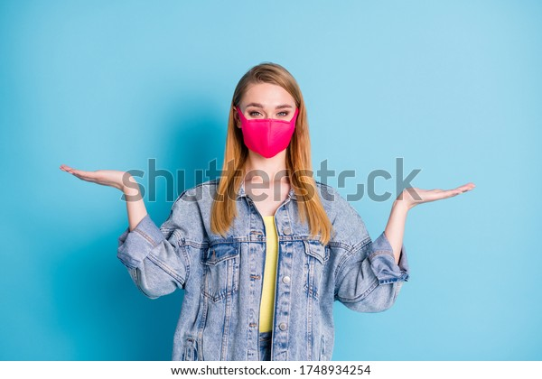 Photo of pretty lady social distancing not contact people hold open palms empty space showing two variants shopping sales discounts wear face mask denim blazer isolated blue color background