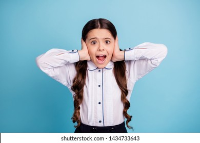 Photo of pretty school lady hands fingers hide ears noisy classroom yelling classmates wear white shirt isolated blue background