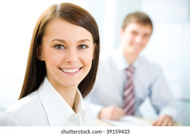 Photo of pretty specialist sitting in office