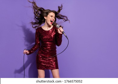 Photo of pretty wavy lady festive party event sing mic favorite song vocalist singer rock song composition wear sequins burgundy dress isolated pastel violet color background