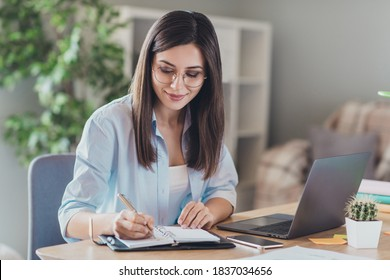 Photo of pretty young girl sit desktop pc hold pen write notepad wear glasses shirt in home office indoors - Shutterstock ID 1837034656