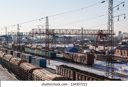 photo of railroad station with carriage and cranes