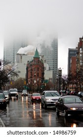 Photo of rainy heavy cloudy street scene in Downtown Toronto, Flatiron building