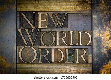 Photo of real authentic typeset letters forming New World Order text on vintage textured grunge copper background