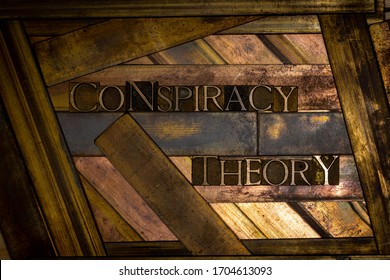 Photo of real authentic typeset letters forming Conspiracy Theory  text on vintage textured grunge copper background