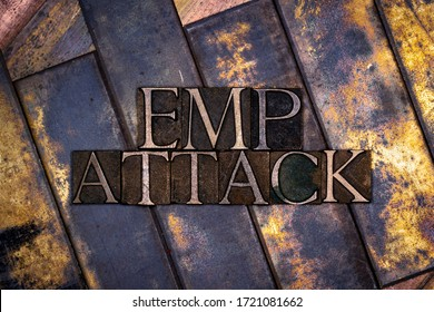 Photo of real authentic typeset letters EMP Attack text on vintage textured grunge copper and gold background