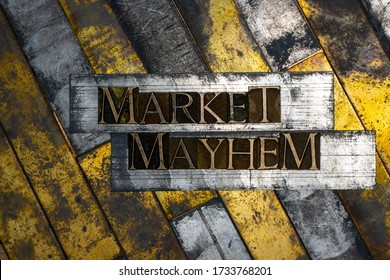 Photo of real authentic typeset letters forming Market Mayhem text on vintage textured grunge copper background