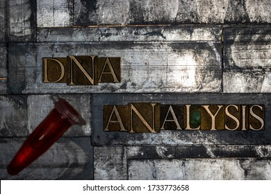 Photo of real authentic typeset letters forming DNA Analysis text with fluid filled laboratory vial on vintage textured grunge silver background